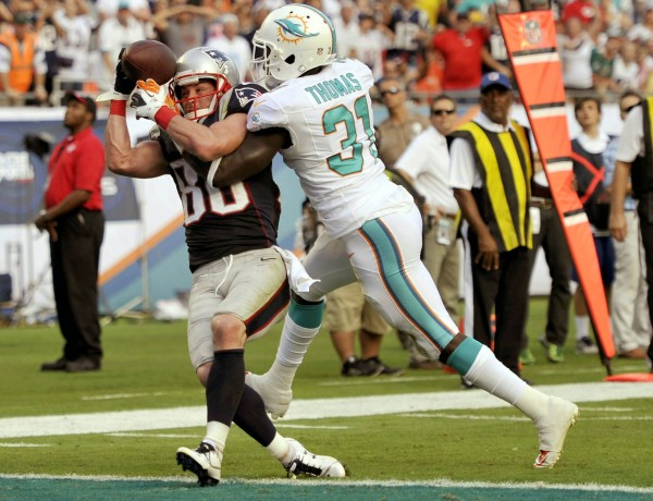 Miami Dolphins safety Michael Thomas (30) breaks up a pass intended for New England Patriots receiver Danny Amendola in the final minute at Sun Life Stadium in Miami Sunday. Miami defeated New England 24-20.