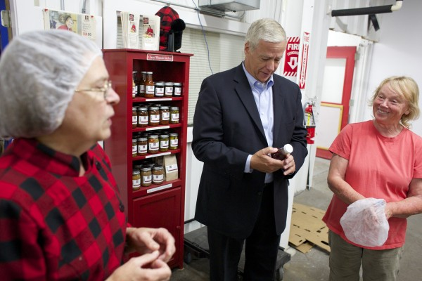 In this Sept. 6 file photo, Cheryl Wixson talks about some of her food products to representative Mike Michaud while getting a tour by Jan Anderson at Coastal Farms and Food Processing in Belfast.