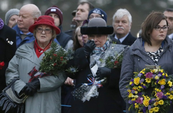 Jane Schultz (center), the mother of a Lockerbie bombing victim, reacts during a memorial event on the 25th anniversary of the bombing of Pan Am flight 103, in Dryfesdale Cemetery, in Lockerbie, Scotland, on Saturday. The community joined friends and relatives of the victims in marking the anniversary of the 1988 bombing of a civilian flight over the town of Lockerbie.