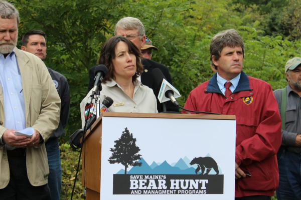 Don Kleiner, executive director of the Maine Professional Guides Association (left), wildlife biologist Jennifer Vashon of the Maine Department of Inland Fisheries and Wildlife, DIF&W commissioner Chandler E. Woodcock (partially obscured) and Sportsman's Alliance of Maine executive director David Trahan listen to a question during a press conference announcing a broad coalition of groups that have banded together to oppose a proposed bear hunting referendum in Maine.