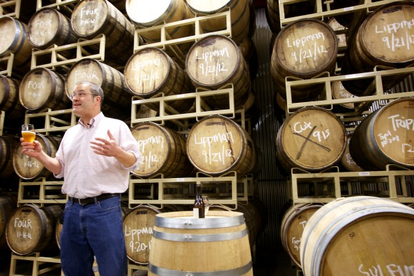 Allagash Brewing Company brewer and founder Rob Tod tastes an experimental beer in a new storage and aging facility next door to the main building in Portland in May.