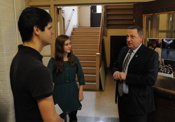 Governor Paul LePage chats with John Bapst seniors Noah Potvin and Jane Branch while on a tour of the school before giving a presentation on domestic violence to a packed auditorium on Friday.
