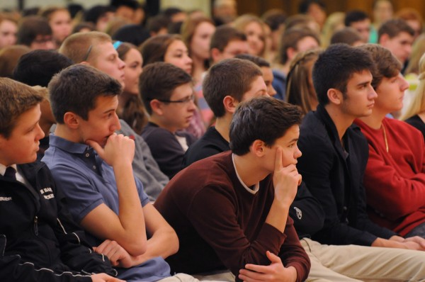 Male members of the student body of John Bapst High School listen as  Governor Paul LePage talks about domestic violence  to a packed auditorium on Friday.