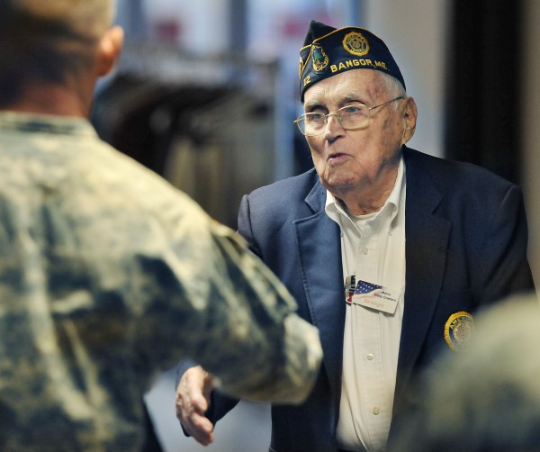 A 'welcome home' and a handshake are what troops passing through Bangor, Maine have been receiving and the first person that they get it from is Bill Knight such as here,  Tuesday, Nov. 10, 2009.