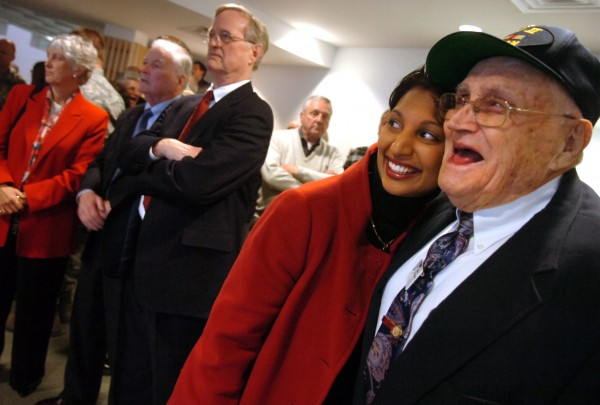 Film producer Gita Pullapilly and Maine Troop Greeter Bill Knight share a moment prior to the debut of &quotThe Way We Get By&quot on Thursday, April 9, 2009, at the Collins Center for the Arts at the University of Maine in Orono.