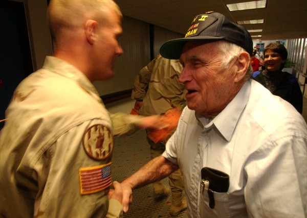 Bradford resident and World War II veteran Bill Knight greets U.S. troops back from Iraq at Bangor International Airport in 2004.