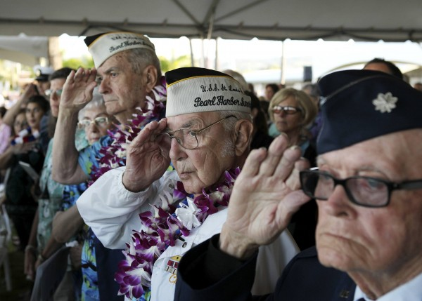 Pearl Harbor survivor Peyton Smith (center) salutes during the &quotMoment of Silence&quot while attending the 72nd anniversary of the attack on Pearl Harbor at the WW II Valor in the Pacific National Monument in Honolulu, Hawaii, on Dec. 7, 2013.