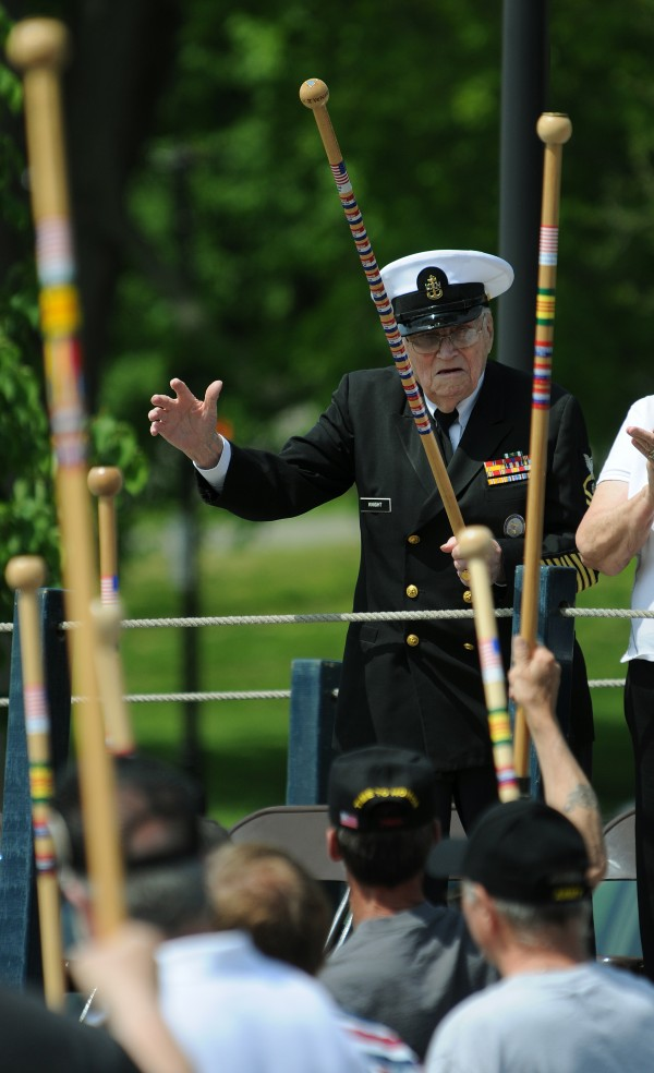 Troop Greeter Bill Knight gets a walking cane salute from fellow veterans while on the reviewing stand on Main Street in Bangor during the Memorial Day parade on Monday, May 30, 2011.