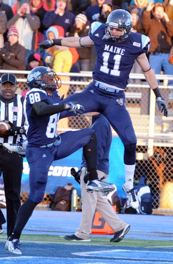 UMaine's John Ebeling (right) and Damarr Aultman celebrate Ebeling's touchdown against UNH late in the second quarter on Saturday at Orono.