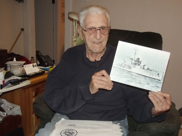 Robert Coles displays a photograph of the USS Bagley, the destroyer he was aboard in Pearl Harbor at the time of the Japanese attack on Dec. 7, 1941.