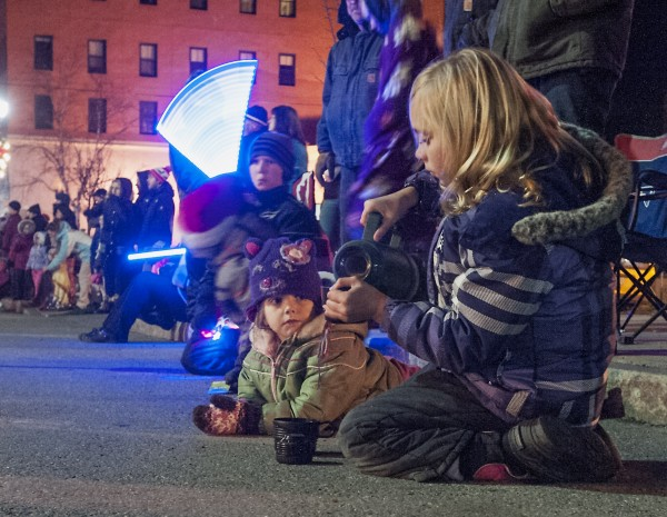 Alisa pours herself some hot chocolate as she and her family watch as the Festival of Lights parade makes its way down Main Street in downtown Bangor, Saturday, Dec. 7, 2013.