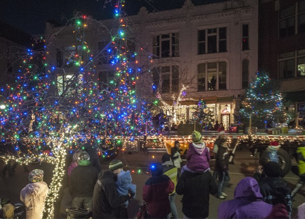 The Festival of Lights parade goes by the Central Street Farmhouse in downtown Bangor, Saturday, Dec. 7, 2013.