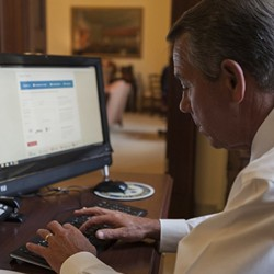 Retooled Obamacare website traffic surges but problems remain