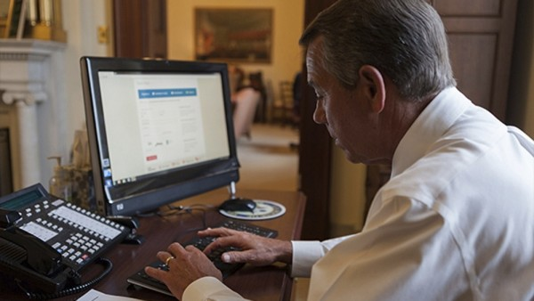 House Speaker John Boehner attempts to sign up for healthcare on the DC Health Link in Washington, in this handout photo courtesy of the Speaker of the House website on November 21, 2013. Boehner said on his blog on the website that he was successfully enrolled after help from the DC Health Link help line.