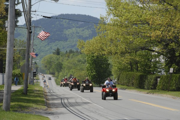 More than a dozen ATVs head east on Pritham Avenue (Route 15) in Greenville in August.