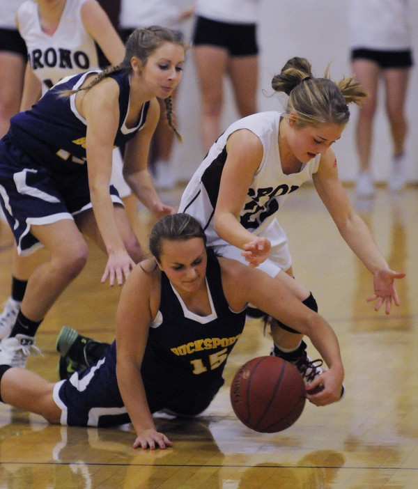 Bucksport's Chloe Stubbs, left, and Deb Wright, center, and Orono's Hannah Clement scramble for a loose ball during Saturday's girls basketball game at Orono.