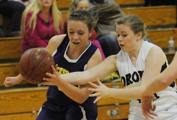 Bucksport's Breanna Coombs steals the ball from Orono's Ally Gonyaron during Saturday's girls basketball game at Orono.