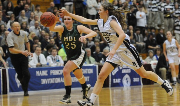 Mount Desert Island's Hannah Shaw and Presque Isle's Hannah Graham chase down a loose ball during the Class B tournament at Bangor Auditorium in February.