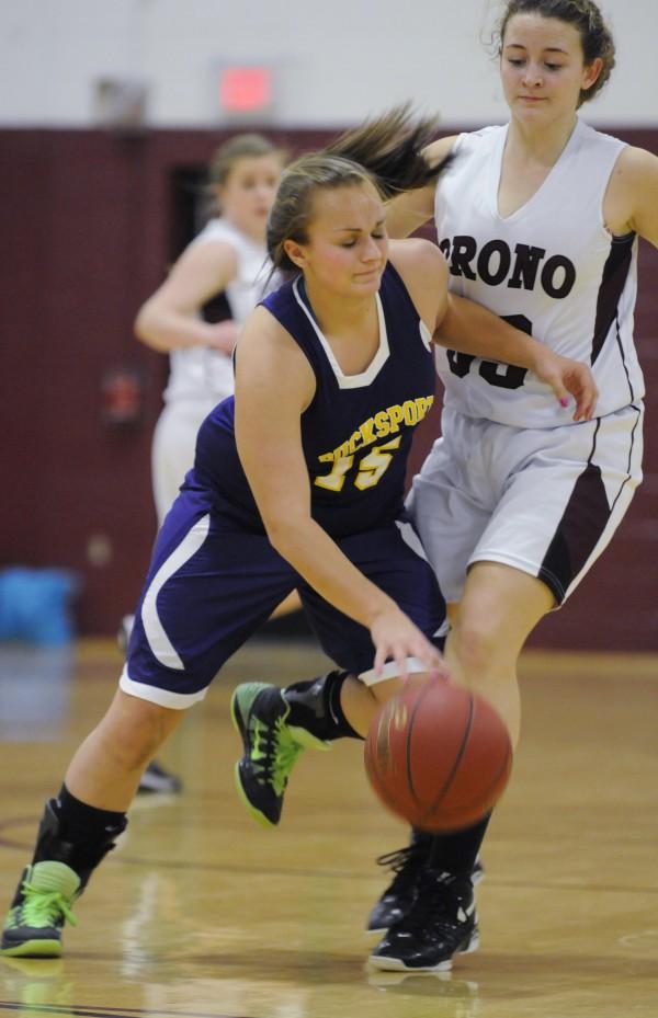 Bucksport's Deb Wright dribbles past Orono's Ana Eliza Souza Cunha during Saturday's girls basketball game at Orono.