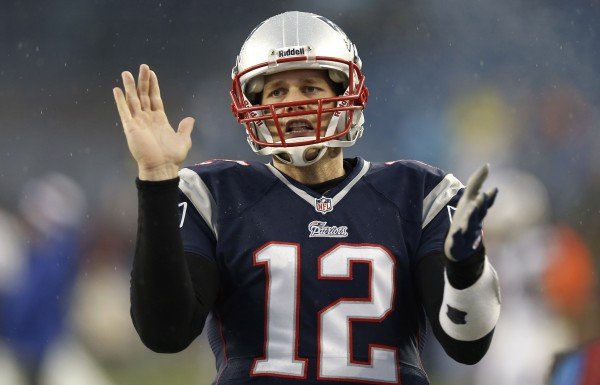 New England Patriots quarterback Tom Brady (12) claps his hands before their game against the Buffalo Bills at Gillette Stadium in Foxborough, Mass., Sunday.