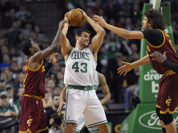 Boston Celtics power forward Kris Humphries (43) grabs a rebound from Cleveland Cavaliers point guard Kyrie Irving (2) and center Anderson Varejao (17) during the second half of Saturday's game at TD Garden. The Celtics won 103-100.
