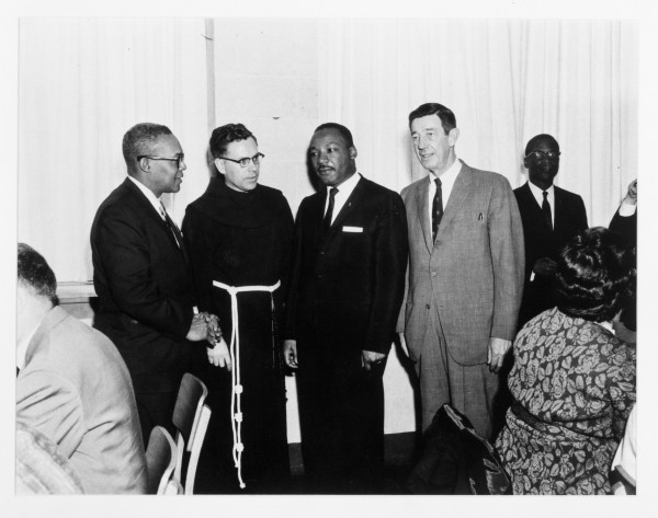 In this 1964 photograph from the University of New England archives, the Rev. Dr. Martin Luther King Jr. (second from the right) is joined by (from left) Waldemar Roebuck, regional director for the New York-based Action for Interracial Understanding; St. Francis College President Rev. Clarence Laplante; and lawyer Harold Carroll, a member of the St. Francis College advisory board.