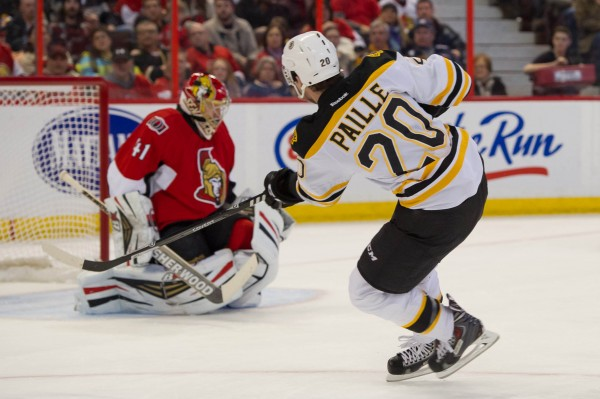 Boston Bruins left wing Daniel Paille (20) scores against Ottawa Senators goalie Craig Anderson (41) during the first period of Saturday's game at the Canadian Tire Centre in Ottawa. The Senators won 4-3.