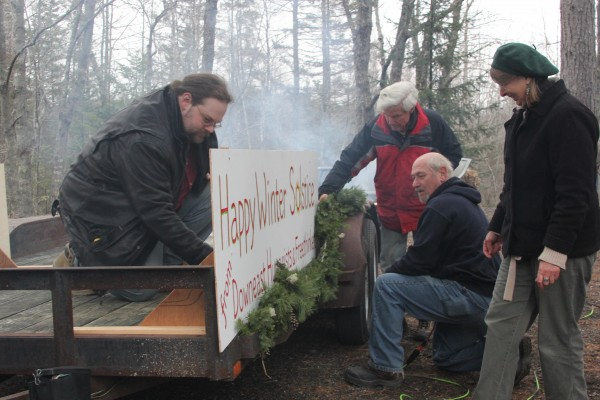 Members of the atheist group Downeast Humanists and Freethinkers, decorate a float for this year's Christmas parade in Ellsworth. The group hopes to draw attention to the Christmas tree's pre-Christian roots.