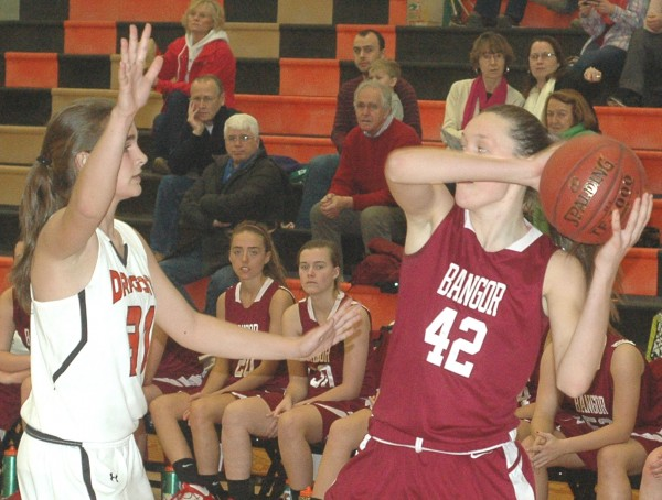 Bangor High School forward Mary Butler (42) tries to get away from Brunswick's Madeline Suhr during Tuesday's KVAC girls basketball game at Brunswick.