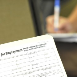 An employment application is shown at the career center in Bangor in 2011.