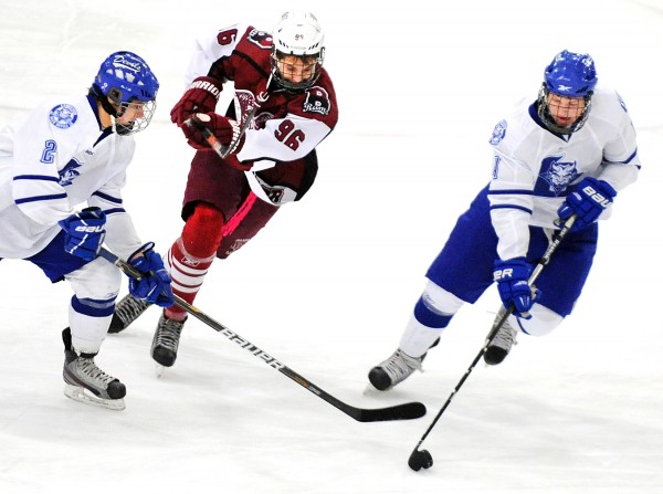 Lewiston's Evan Gosselin (left) and Max Bolduc (right) steal the puck away from Bangor's Jordan Tracy during a game at the Androscoggin Bank Colisee in Lewiston on Monday, Jan. 21, 2013.