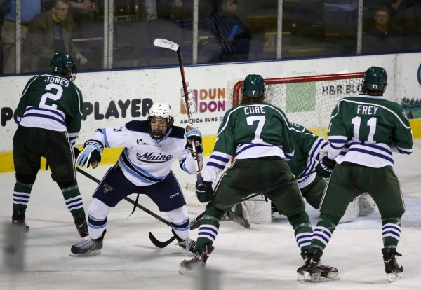 Ryan Lomberg of the University of Maine (second left), shown after scoring in a Jan. 4 game against Mercyhurst, hopes to light the lamp for the Black Bears during the Florida College Classic this weekend in Estero, Fla.