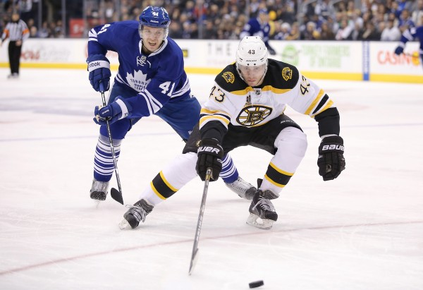 Boston Bruins defenseman Matt Barykowski chases the puck as Toronto Maple Leafs left wing Nikolai Kulemin applies pressure at the Air Canada Centre Sunday night in Toronto. The Bruins won 5-2.
