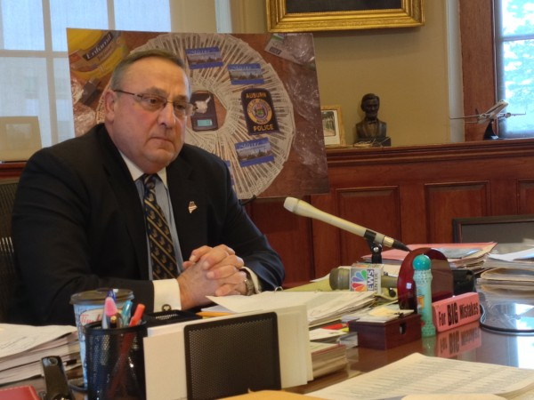 Gov. Paul LePage speaks with reporters from his office in the State House on Dec. 19.