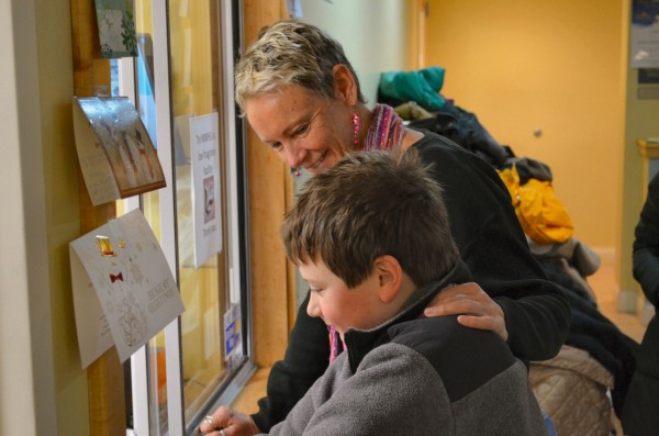 Waterville Mayor Karen Heck greets Evan Vigue, 9, of Waterville after he donates $65.43 he raised with his two friends Owen Harris, 10, and Carson Harris, 5, both of Waterville, to the Mid-Maine Homeless Shelter on Monday.