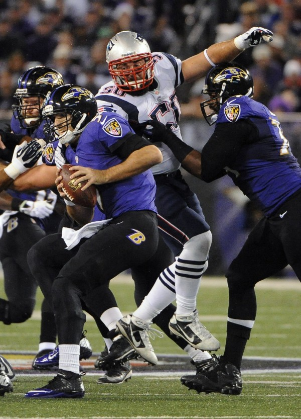 The New England Patriots' Rob Ninkovich (50), center, beats the Baltimore Ravens' Michael Oher, right, to sack Ravens quarterback Joe Flacco, left, in the second quarter in Baltimore on Sunday.