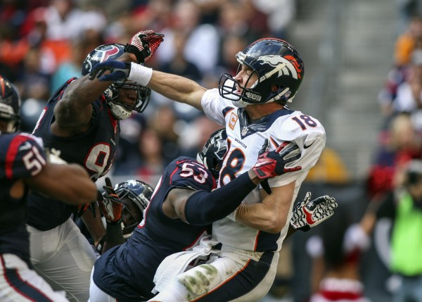 Denver Broncos quarterback Peyton Manning (18) throws the ball during the third quarter Sunday as Houston Texans inside linebacker Joe Mays (53) applies pressure at Reliant Stadium. The Broncos defeated the Texans 37-13.