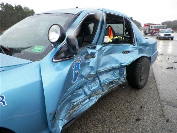This state police cruiser driven by Trooper William Baker was destroyed in an accident on the Maine Turnpike on Sunday.