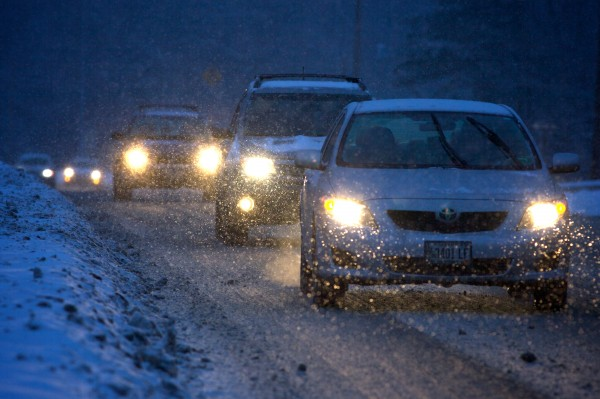 Commuters make their way through snow at dusk in Yarmouth on Thursday.