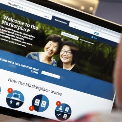 A man looks over the Affordable Care Act signup page on the HealthCare.gov website in New York in this Oct. 2, 2013 photo.