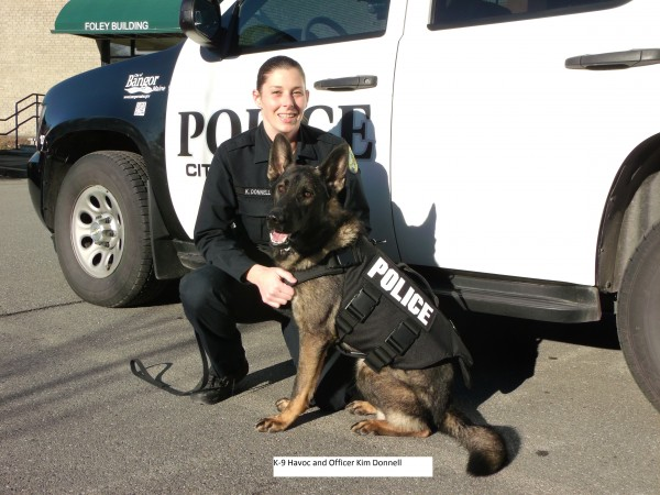 Bangor police canine Havoc and his handler, Officer Kim Donnell, show off one of the new protective canine vests the department recently received.