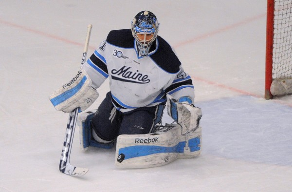 University of Maine goalie Martin Ouellette makes a save against American International in Orono recently.