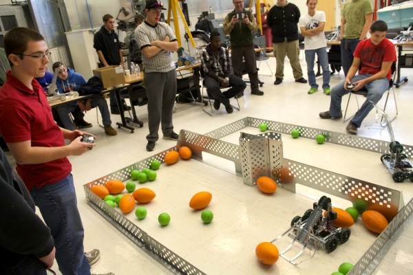 Brandyn Hobbs (left), 17, and Casey Roy of Lewiston Regional Technical Center battle it out in a robotics competition in Brunswick on Tuesday. The University of Maine Brunswick engineering program, in partnership with Southern Maine Community College, hosted the robotics and engineering event.