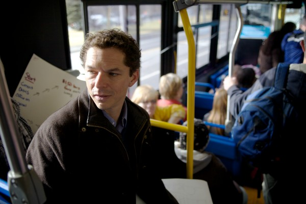Senate President Justin Alfond rides Portland's number five bus from downtown to South Portland Tuesday where the state wants to move DHHS offices.