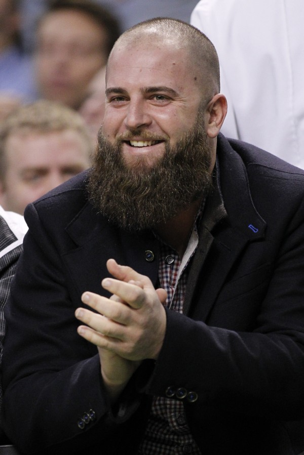 Boston Red Sox first baseman Mike Napoli reacts during the fourth quarter of the game between the Boston Celtics and the Charlotte Bobcats at TD Garden. The Charlotte Bobcats won 89-83.