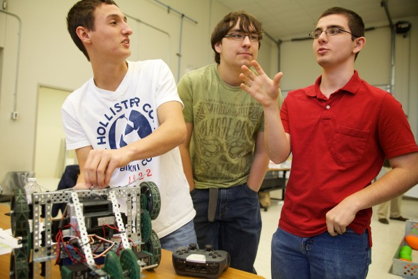 Lewiston Regional Technical Center students Kyle Ridley (from left), 18, his robotics partner Ben Lowit, 17, and Brandyn Hobbs, 17, discuss tactics before the final events of a robotics competition in Brunswick on Tuesday. Ridley and Lowit went on to win first place.
