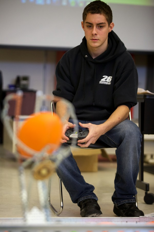 Tyler Cook of Lewiston Regional Technical Center practices operating a robot at a competition in Brunswick on Tuesday. The University of Maine Brunswick engineering program, in partnership with Southern Maine Community College, hosted the robotics and engineering event.