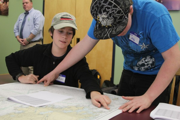 Liam Griffith, 14, worked with another student to mark locations where winter flounder had been caught on a nautical chart. He is one of 45 students participating in the Eastern Maine Skippers Program.