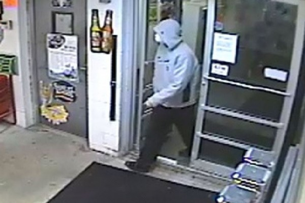 Portland police are distributing this surveillance camera footage of a man they say brought a rifle into a liquor store, announced that his weapon was loaded and then fled.