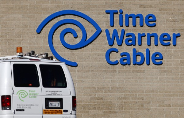 A cable truck returns to a Time Warner Cable office in San Diego, Calif., this week.